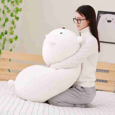 a girl hugs white soothing plush pillow