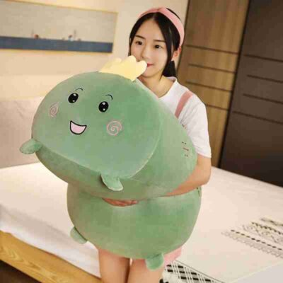 a happy girl hugs green soothing pillow