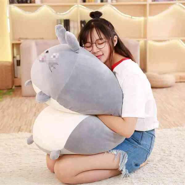 girl hugs totoro soothing plush pillow